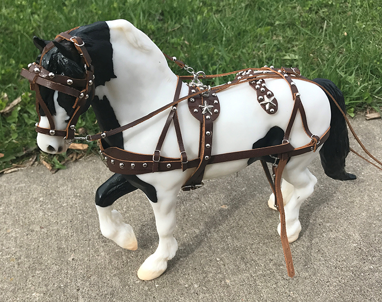 brown driving harness on gypsy horse