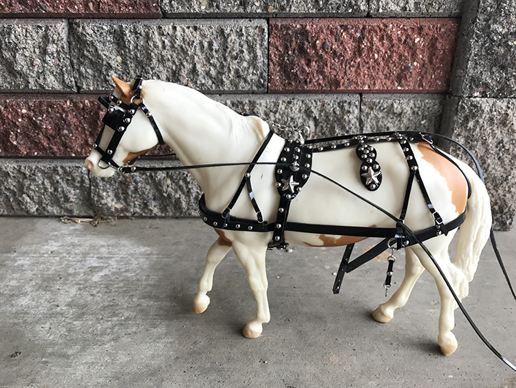 driving harness on white horse
